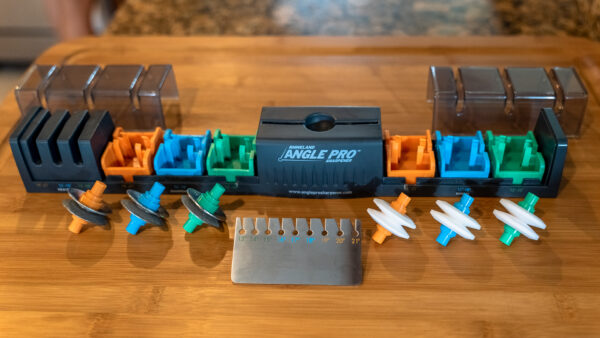 Angle Pro Sharpener disassembled on a wood cutting board; Promo Shot